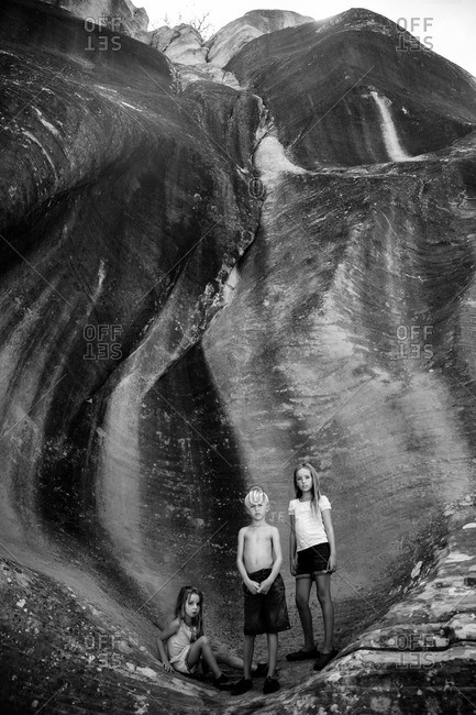 Three children in a crevice in Bryce Canyon, Utah