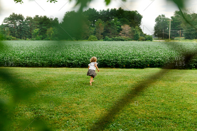 Little girl playing on a lawn