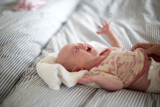 Crying baby getting undressed