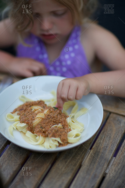Girl with linguine pasta on plate