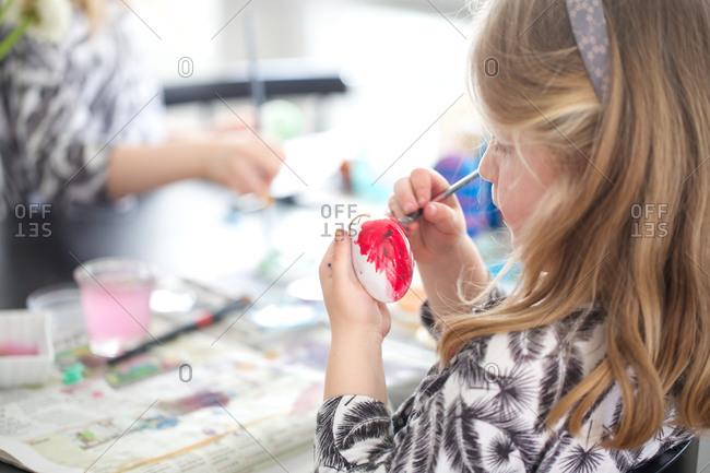 Girl painting Easter eggs Easter celebration