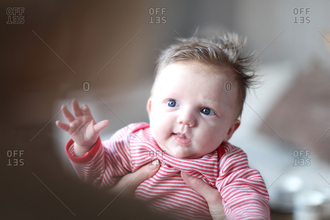 Cute baby with hair and blue eyes