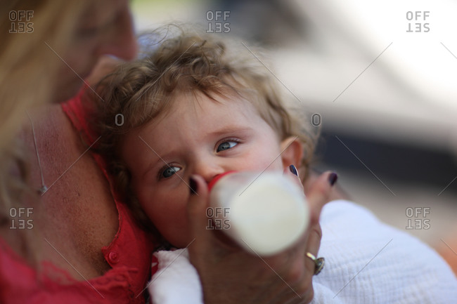 Business mother bottle feeding baby