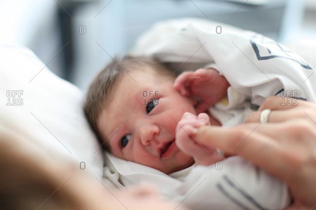 Newborn looking up has his mom