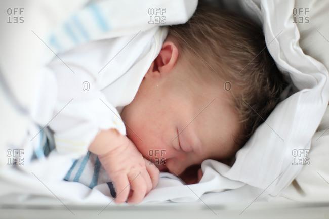Cute newborn baby with hair sleeping