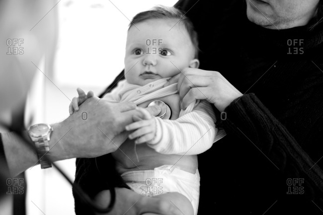 Cute baby getting medical check up