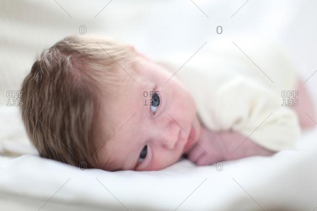 Tired newborn baby lying on stomach