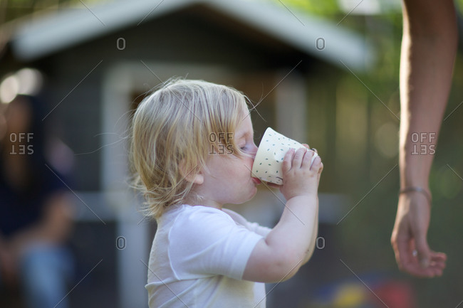 Girl drinking from glass thirsty