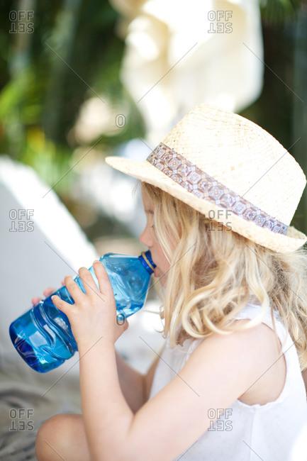Girl drinking water bottle - Offset