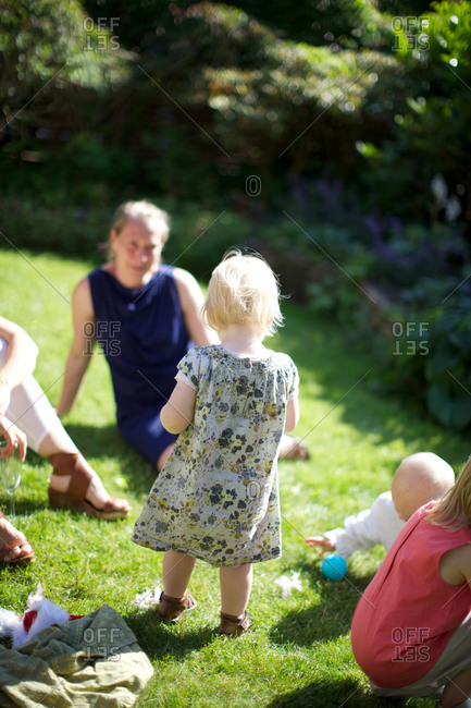 Mother with kids playing in garden