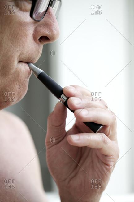 Male smoker with e-cigarette
