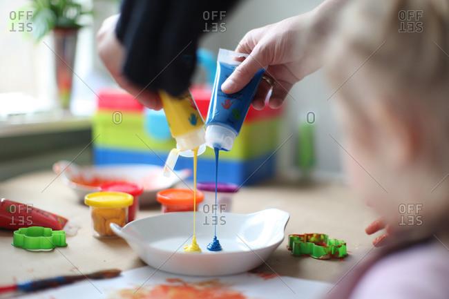 Mixing paints for kindergarten class