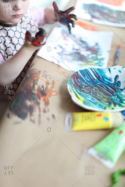 Finger painting in kindergarten