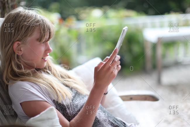 Teenage girl on terrace - Offset
