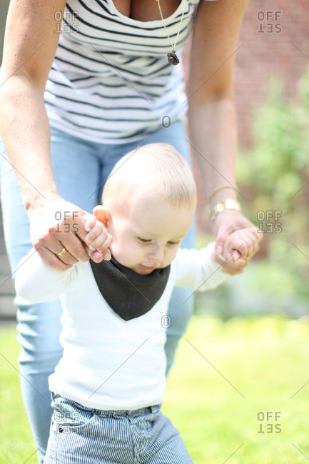 Baby boy learning to walk