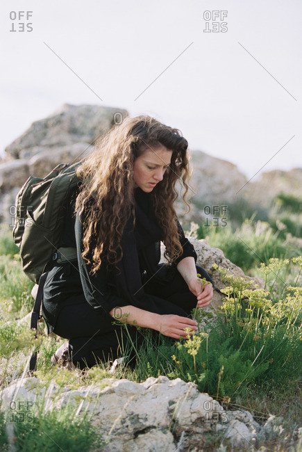 A woman picking wild flowers