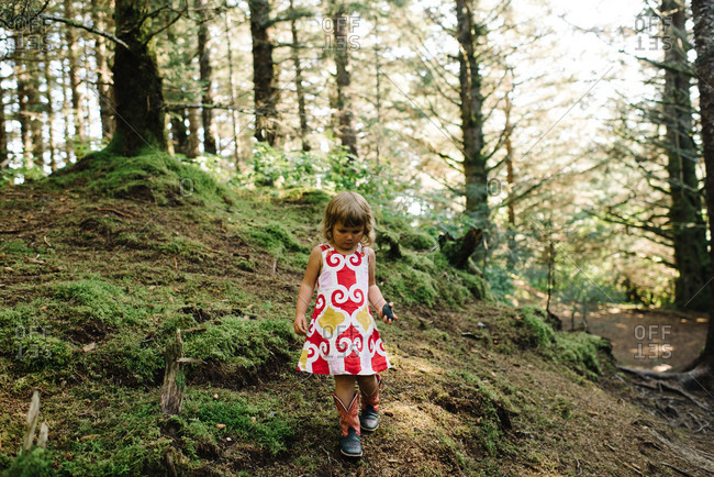 Little girl exploring a forest
