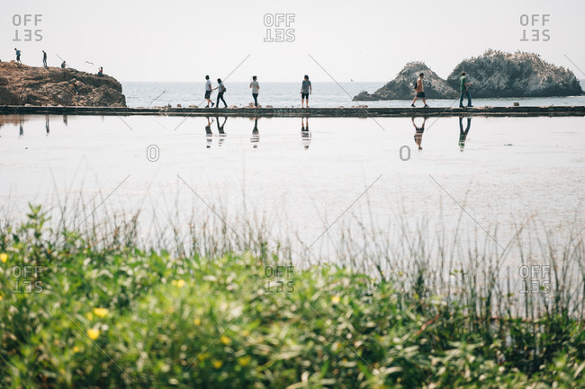 Tourists explore the area around Sutro Baths in Golden Gate National Recreation Area