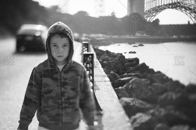 Young boy in a hoodie at the Fort Point Overlook of Golden Gate Bridge