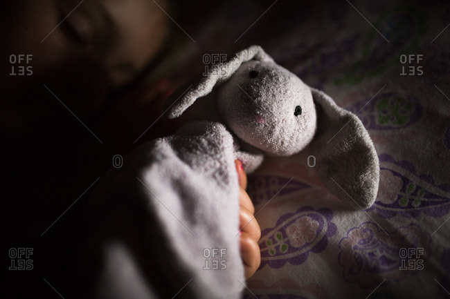 Child's sleeping with her beloved rabbit lovey
