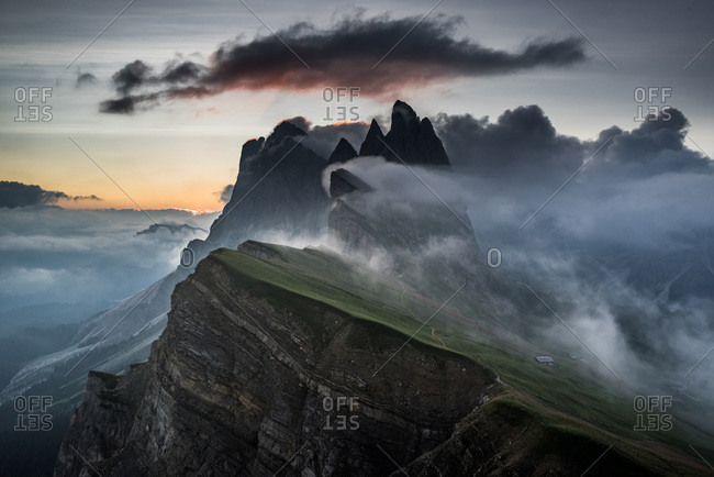 Fog covered cliffs in the Italian alps