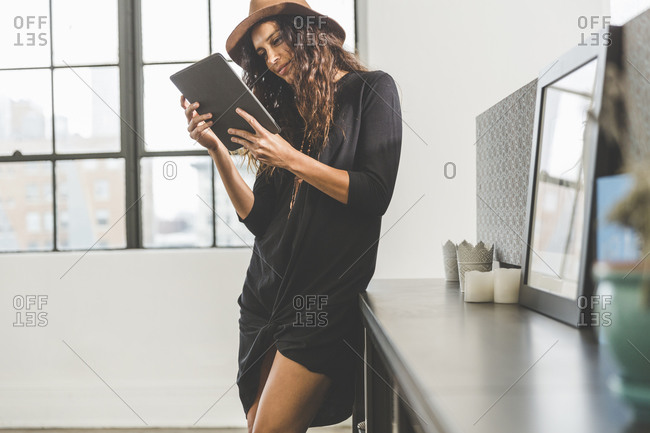 Woman looking at a smart tablet