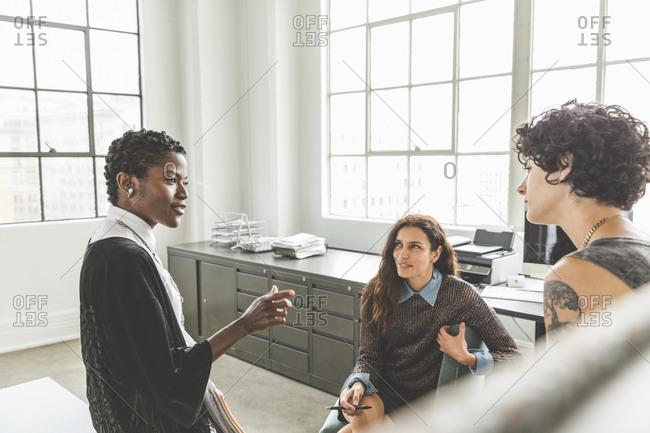 Women having a conversation in an office