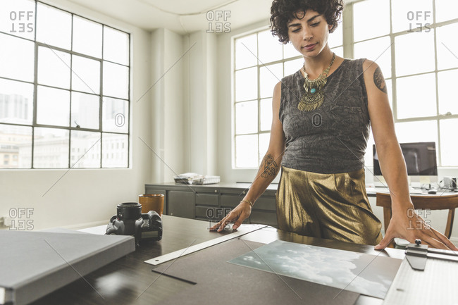 Woman looking at photo in a studio office