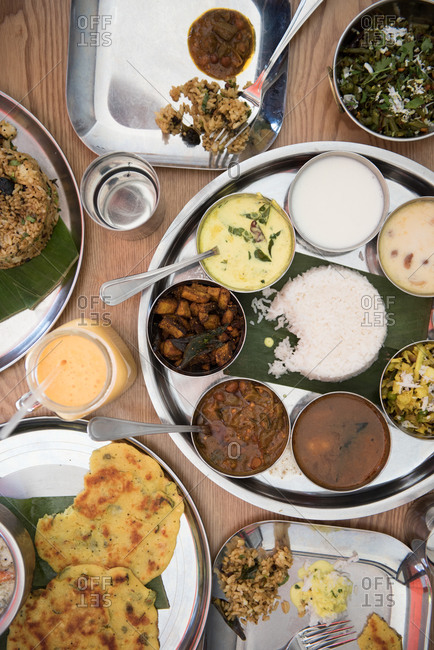 Spread of vegetarian Indian dishes and condiments