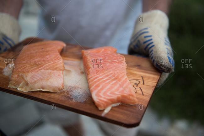 Filets of salmon on a cedar plank