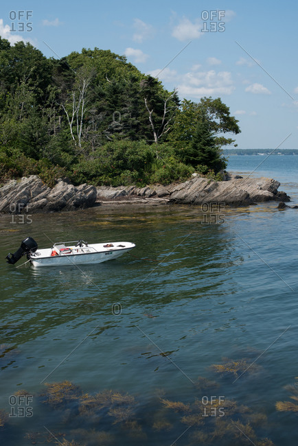 Boat anchored in shallow water at Basket Island, Maine