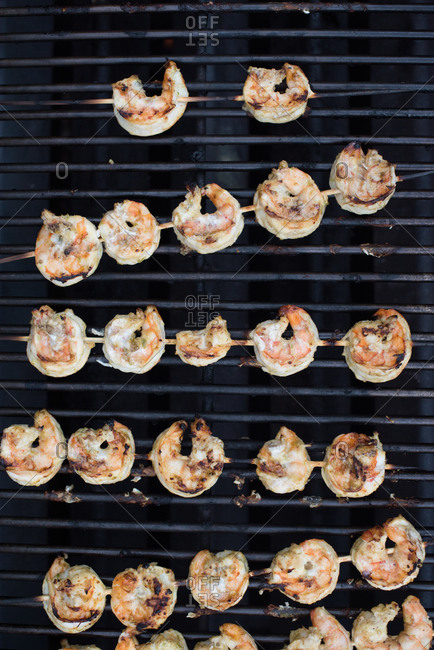 Skewers of shrimp on a grill