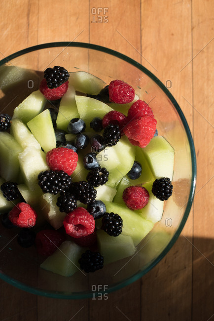 Bowl of berry and honey dew fruit salad
