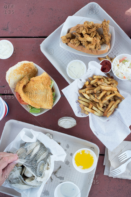 Plates of seafood on a picnic table