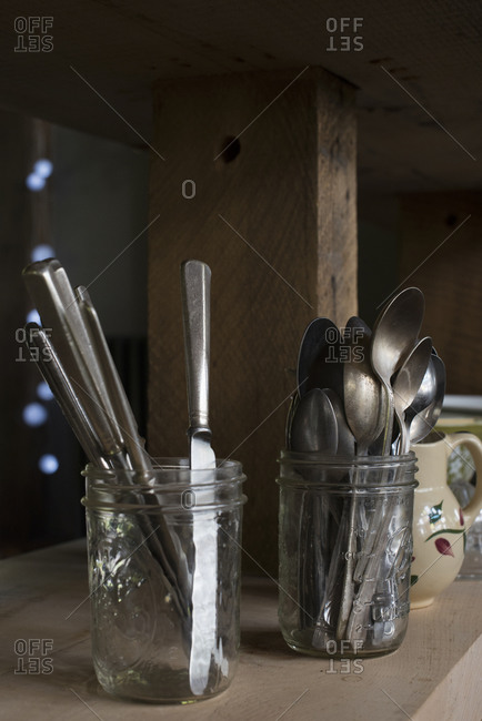 Spoons and butter knives in mason jars
