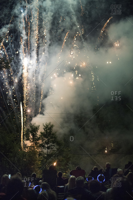 Fireworks exploding above a crowd