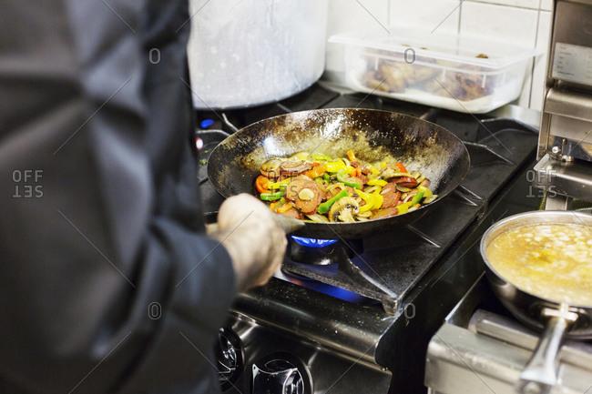 Man cooking vegetables