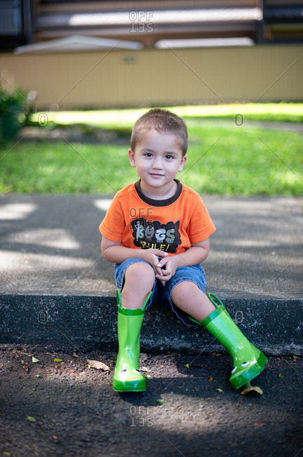 Portrait of a boy wearing rain boots
