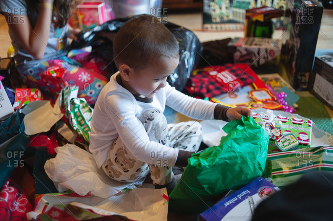 Little boy opening Christmas presents
