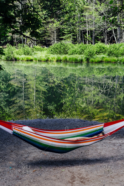 Woman in a hammock by a lake