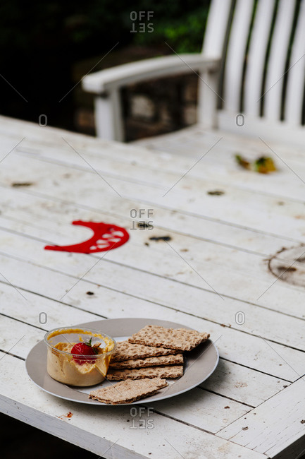 Plate with hummus and crackers