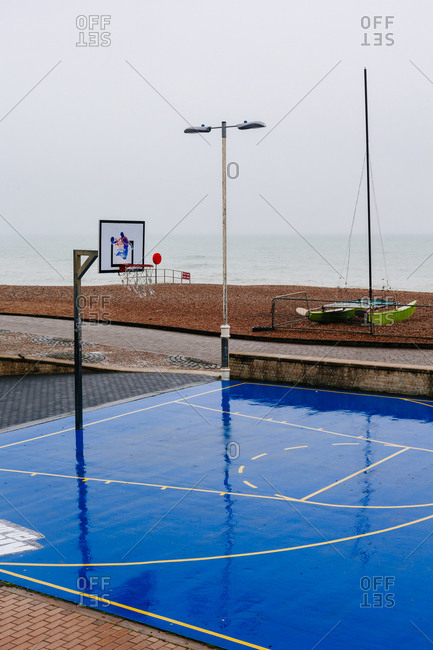 A basketball court in the rain