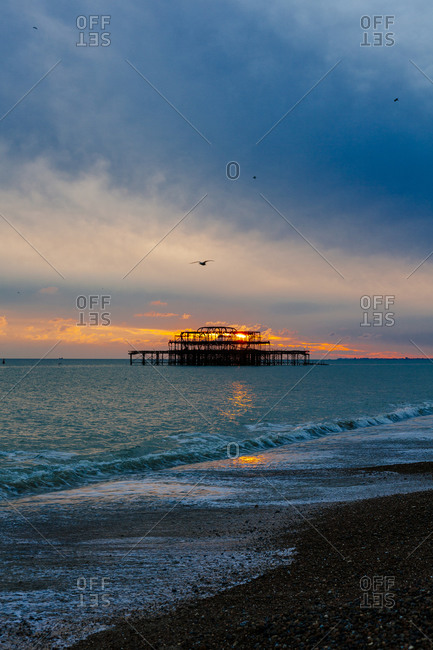 The old west pier at sunset in Brighton