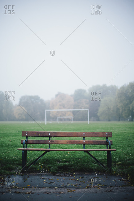 Bench and a soccer goal in the rain at Victoria Park in London
