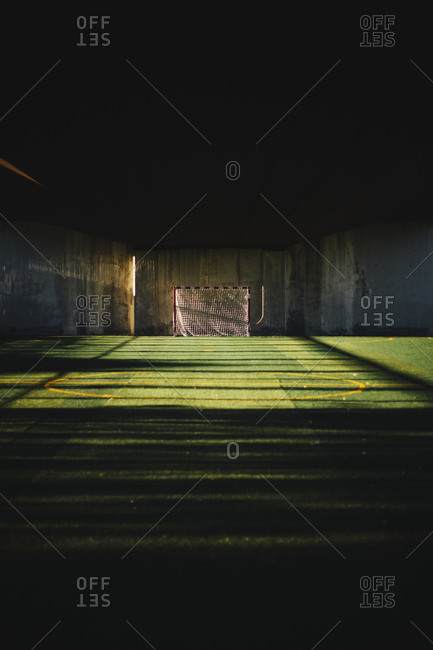 A soccer field under a bridge