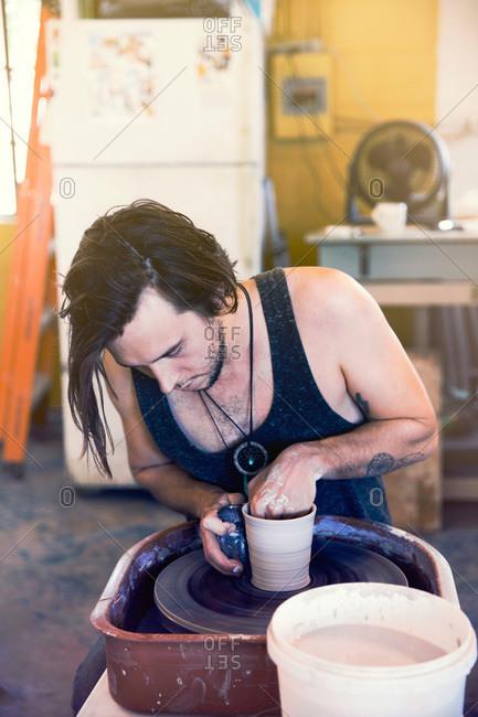 Ceramist at a pottery wheel