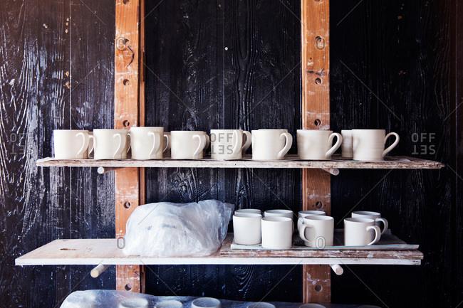 Unglazed pottery on shelves at a ceramist's studio