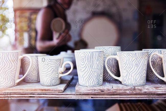 Finished mugs at a ceramist's studio