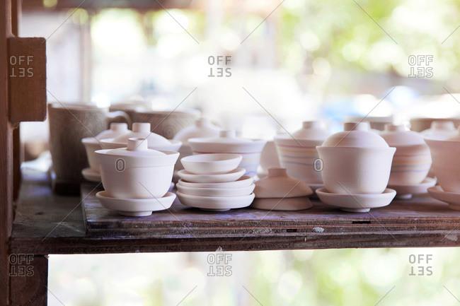 Pottery on a shelf in a ceramist's studio