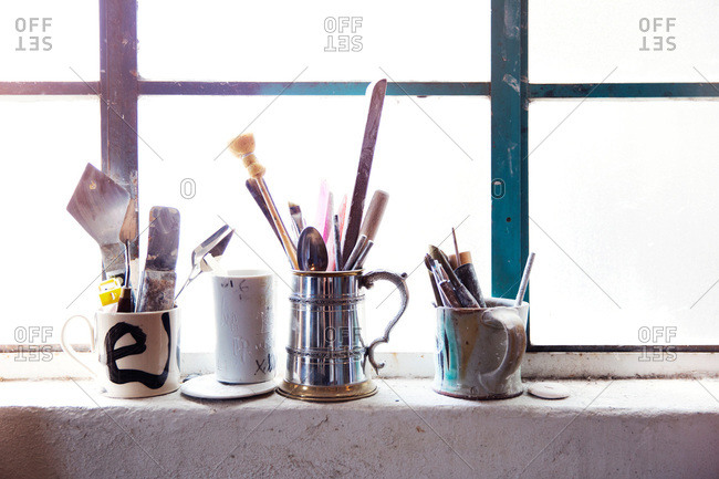 Brushes and other tools in a ceramist's studio